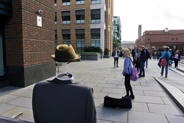 Street entertainer dressed as the Invisible Man, London, England
