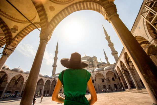 Woman at the Blue Mosque in Istanbul