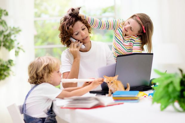 Woman working home with kids
