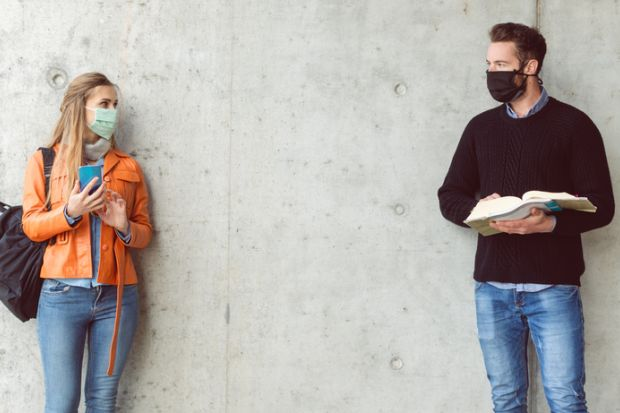 Students socially distancing with face masks