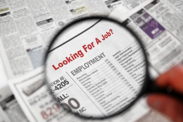 Magnifying glass searching job adverts illustrating graduate outcomes survey results