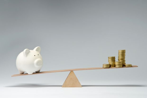 Piggy bank and money on a see-saw