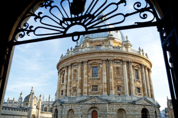 A view of the Radcliffe Camera through a gate at the University of Oxford in England