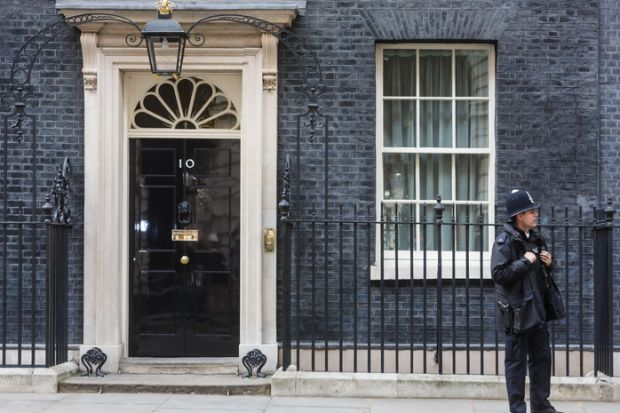 A police officer outside No.10 Downing Street, London