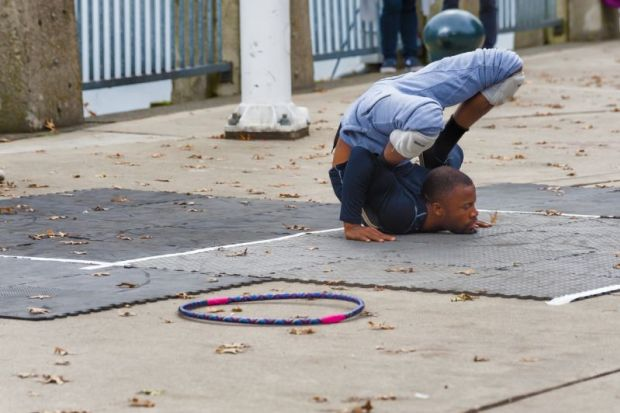 uncomfortable position contortion street performer
