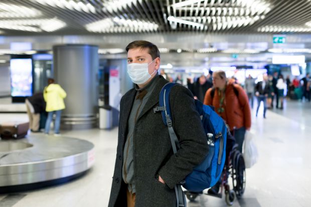 coronavirus face-mask arrival hall airport