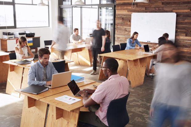 hot desks open plan office workers busy