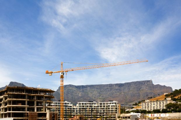 Table Mountain behind a construction site in Cape Town, South Africa