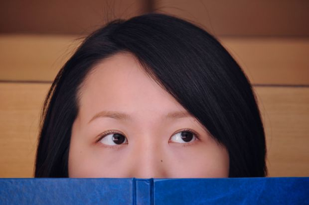 Female Chinese student with book