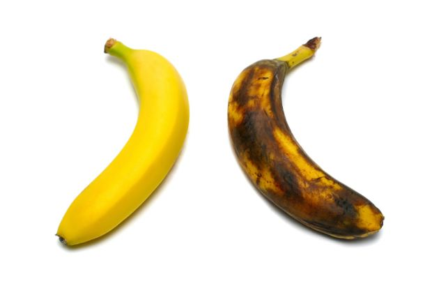 Two bananas: one yellow, one brown