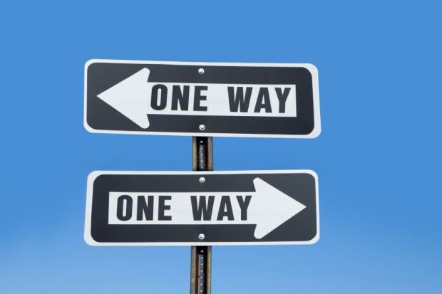 'One way' signs pointing in two directions