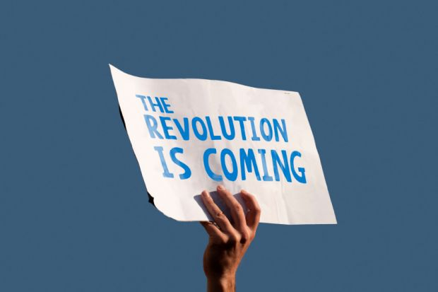 "Sign saying ""The revolution is coming"""