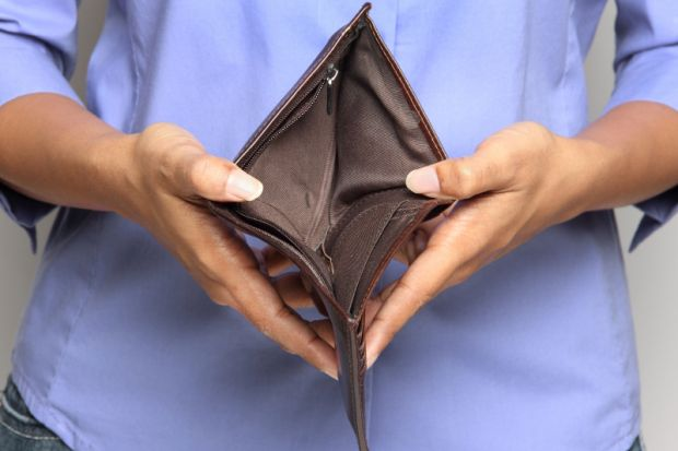 Person holding an empty wallet