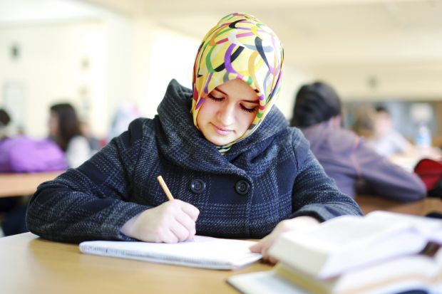 Student with head scarf