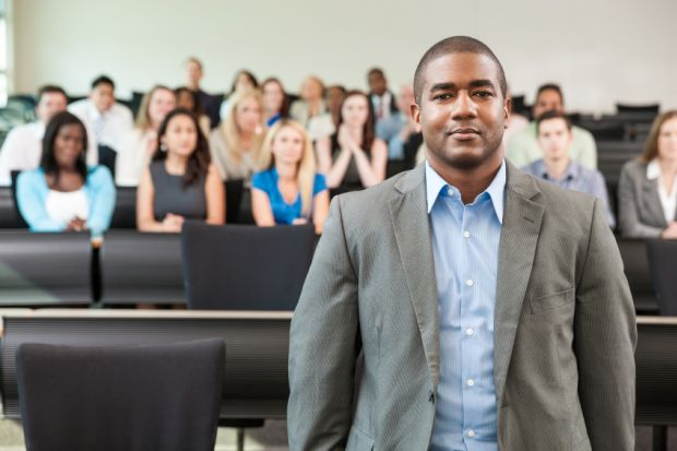 Black academic in lecture theatre