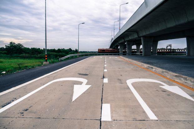U-turn sign painted on road