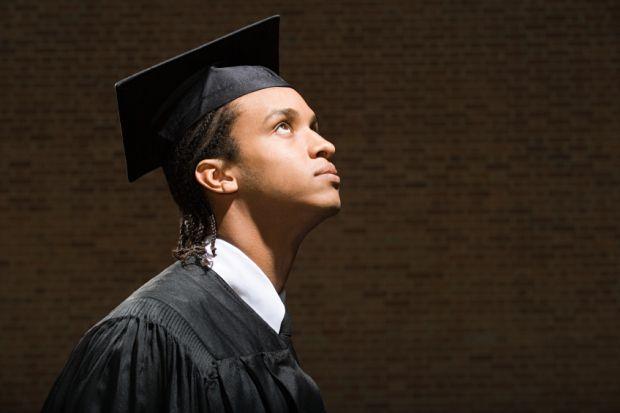 Black graduate looking up