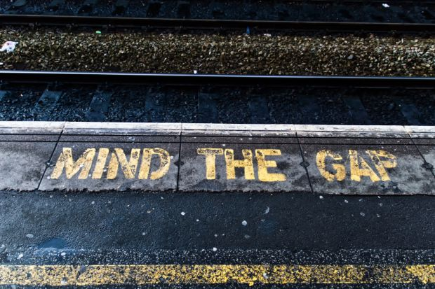 'Mind the gap' lettering on a railway station platform