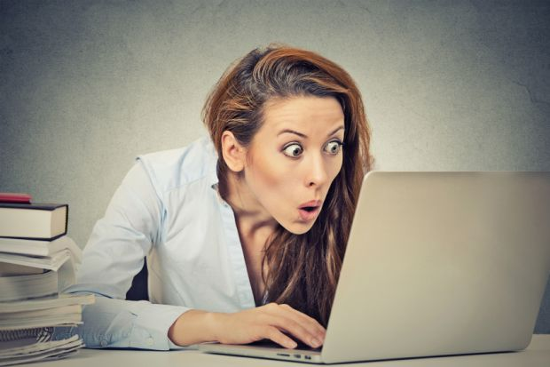 Shocked woman at computer