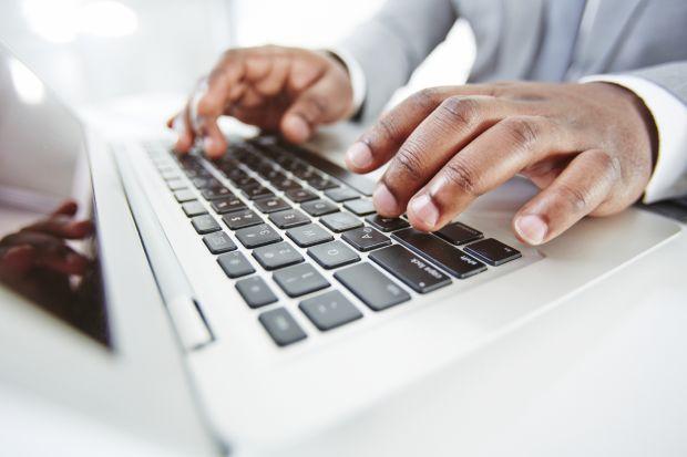 Black academic writing an application