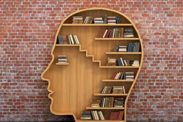 Books on head-shaped shelving