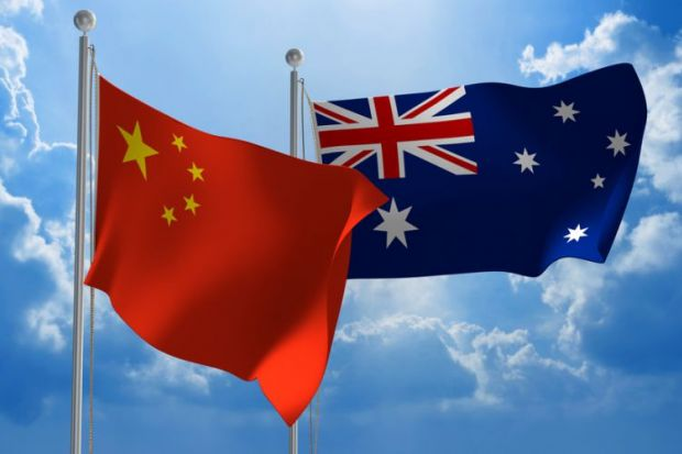 Chinese and Australian flags flying