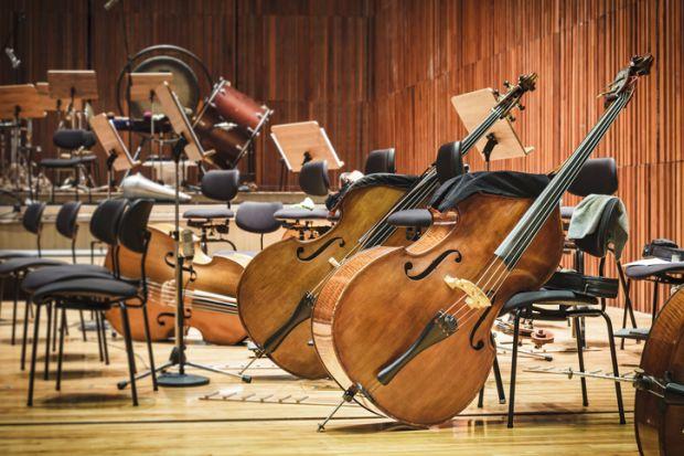 Cellos in an empty auditorium