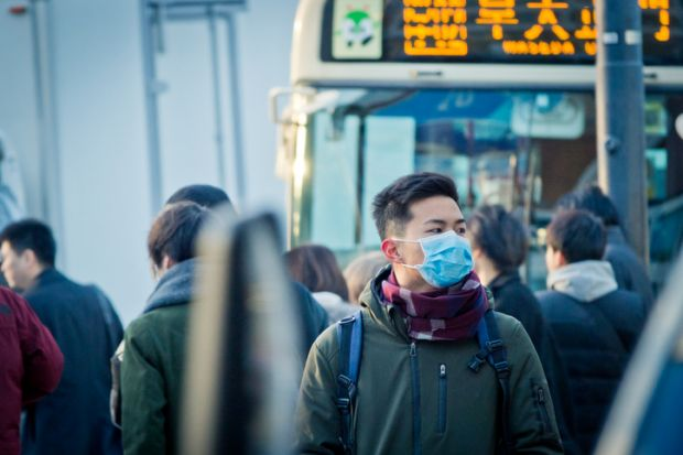 Man wearing mask on the street at rush hour in Japan