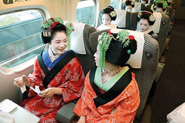 Japanese geishas on train