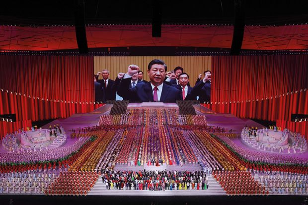 A large screen showing President Xi Jinping during the art performance celebrating the 100th anniversary of the founding of the Communist Party of China on June 28, 2021 in Beijing, new Cold War.