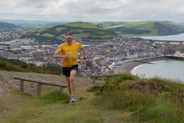 John Grattan running Ironman