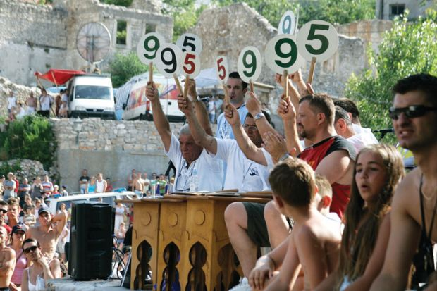Judges scoring bridge jumping contest, Mostar, Bosnia