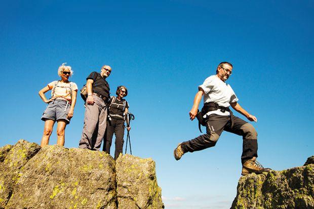 Man jumping across rocks