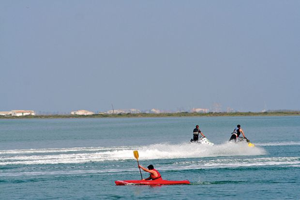 Kayaker and jet skiiers