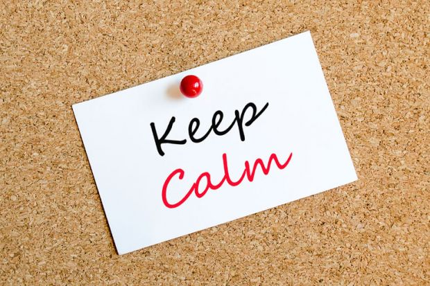 'Keep calm' note pinned to corkboard