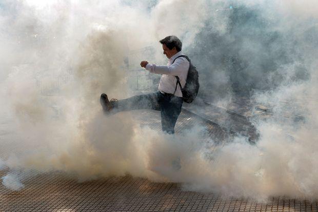 man kicks cloud of smoke