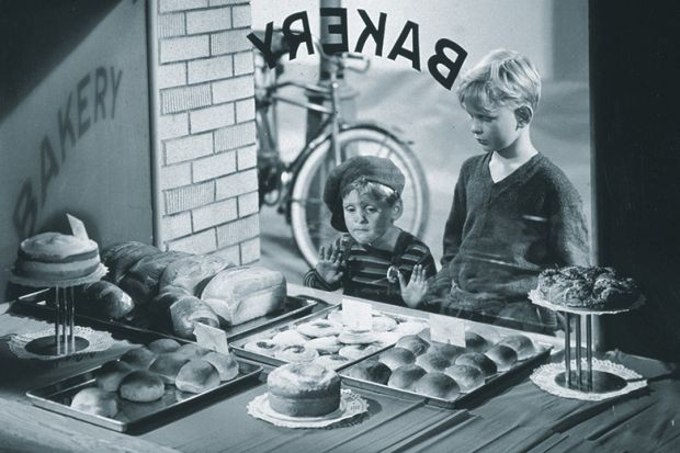 Kids looking through bakery window