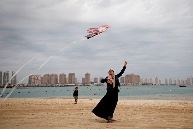 Flying kite on beach