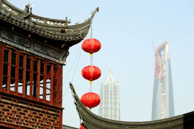 Red lanterns hanging from a temple roof in Shanghai
