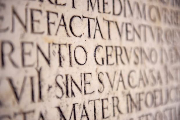 Latin inscription on wall