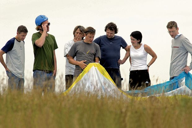 People learning to paraglide