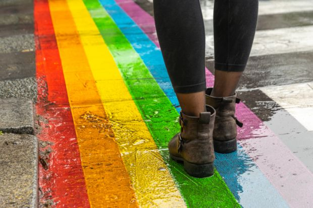 Legs walking on rainbow crossing, LGBT+ inclusion