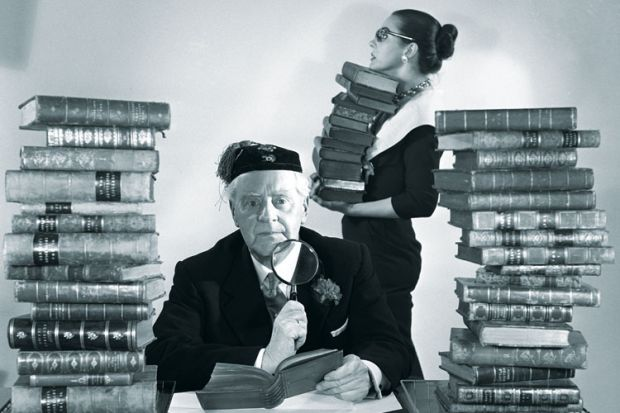 Librarians with piles of books