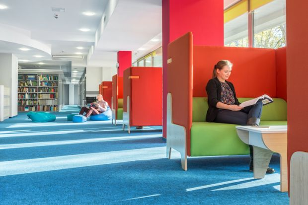 Library with individual study area with red partition and green sofa