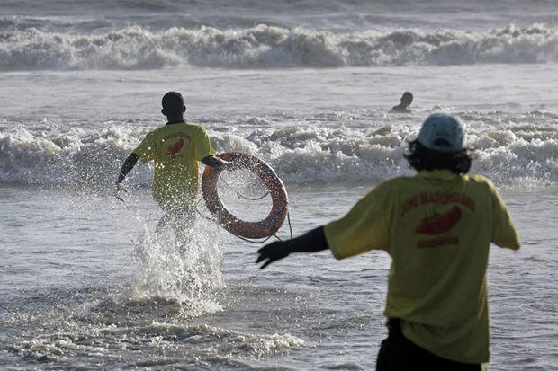 Life guards demonstrate the skill of saving lives at Juhu Beach, Mumbai