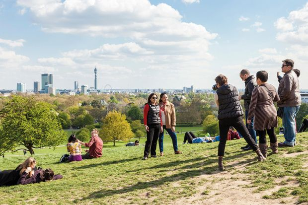 People photographing friends, Primrose Hill, London
