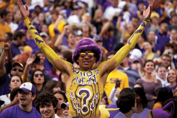 Louisiana State University student celebrating at American football game