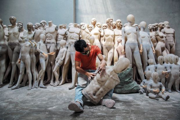 An employee works on a mannequin at the 'A Top Mannequin' factory