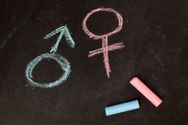 Male/female gender symbols drawn in chalk