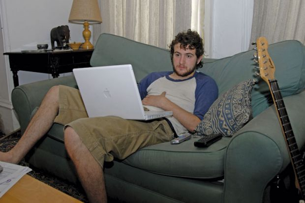 Male student using Apple laptop